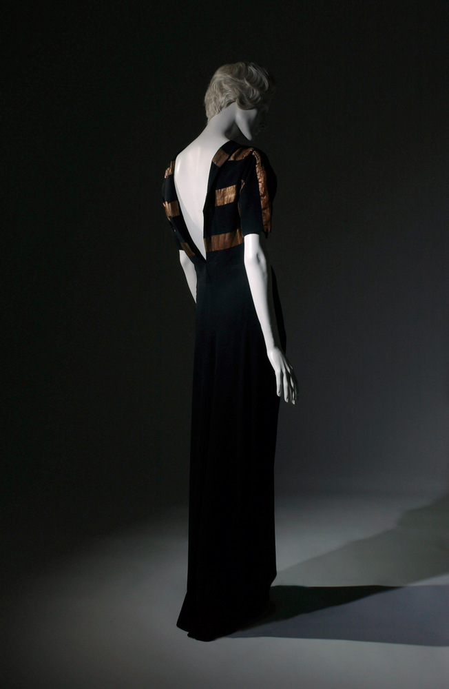 Augustabernard Gown Black crepe, lame 1933, France The Museum at FIT, 70.57.65 Gift of Mr. Rodman A. Heeren